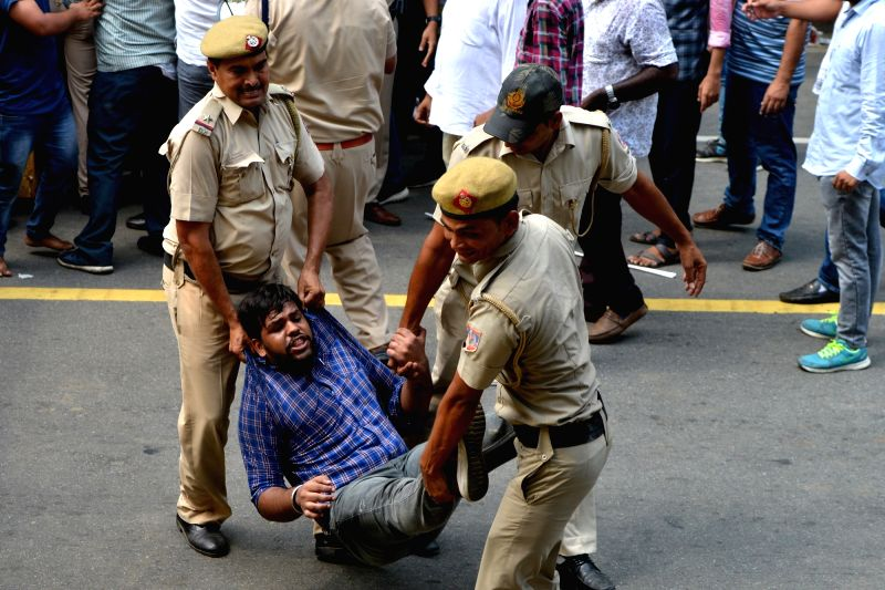 New Delhi: Activists of National Students' Union of India (NSUI) - the students wing of the Congress - staging a demonstration against the arrest of senior party leader D.K. Shivakumar, being taken away by the police in New Delhi on Sep 4, 2019. (Pho