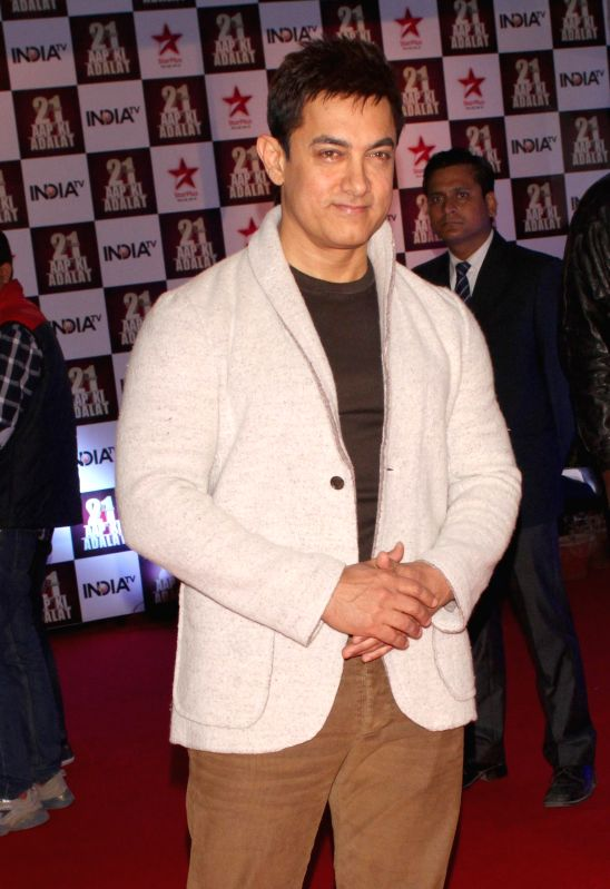 Actor Aamir Khan during a programme organised to celebrate 21 years of a `Aap Ki Adalat` a TV show at Pragati Maidan in New Delhi on Dec 2, 2014. - Aamir Khan