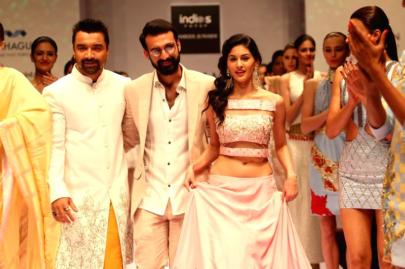 Actor Ajaz Khan and actresss Amyra Dastur walk on the ramp at India Runway Week show, in New Delhi, on April 12, 2014. - Ajaz Khan