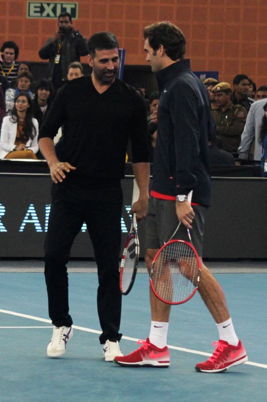 Actor Akshay Kumar with Indian Aces player Roger Federer during an IPTL match at Indira Gandhi Indoor Arena in New Delhi, on Dec 8, 2014.