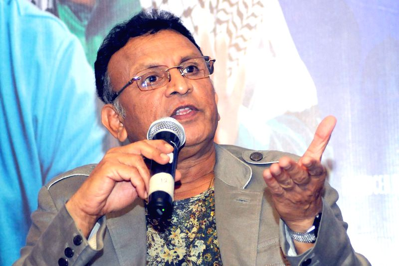 Actor Annu Kapoor during a press conference to promote his upcoming film `Dharam Sankat Mein` in New Delhi, on April 6, 2015. - Annu Kapoor