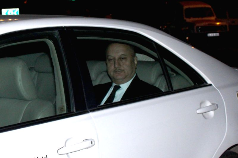 Actor Anupam Kher arrives to attend the marriage ceremony of cricketer Suresh Raina in New Delhi on April 3, 2015. - Anupam Kher