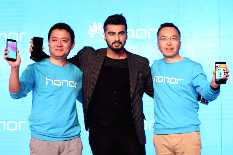 Actor Arjun Kapoor with Honor Mobiles president George Zhao and Honor Mobiles president consumar business Allen Wang during the launch new smartphones of Honor 6 Plus and 4X in New Delhi ...