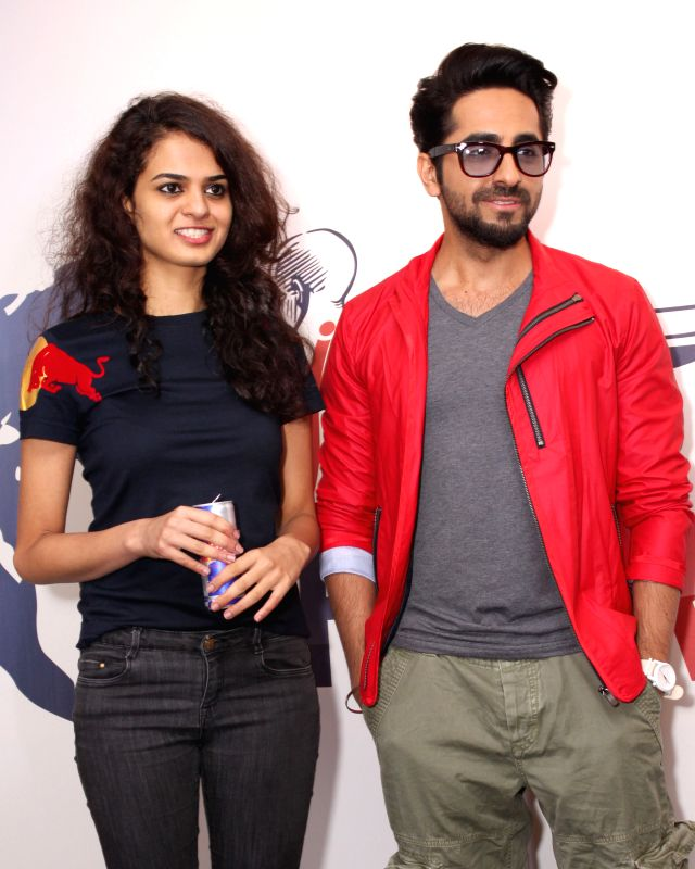 Actor Ayushmann Khurrana with chess player Tania Sachdev during a programme to announce the 2nd edition of `Wings For Life World Run` in New Delhi, on April 8, 2015. - Ayushmann Khurrana