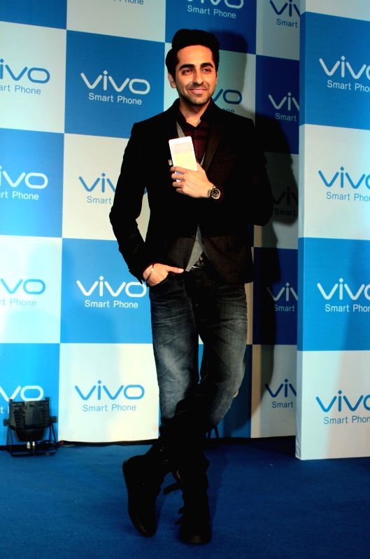 Actor Ayushmann Khurrana with the CEO of vivo Mobile Jacky Liao at the launch of a vivo mobile in New Delhi, on Dec 15, 2014. - Ayushmann Khurrana
