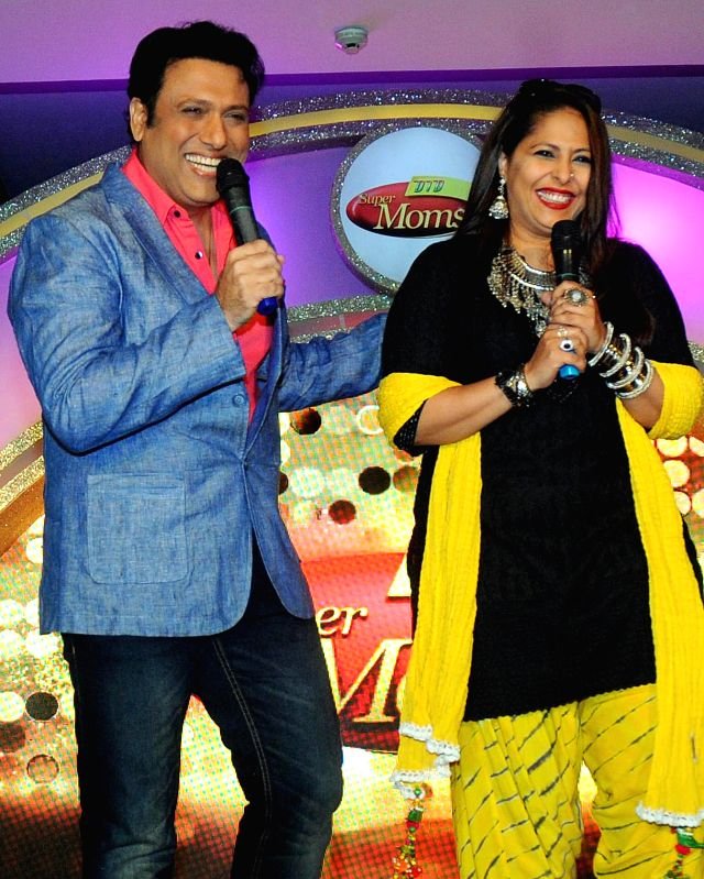 Actor Govinda and Indian choreographer Geeta Kapoor at the launch of `Dance India Dance Super Moms` in New Delhi, on March 16, 2015. - Govinda and Geeta Kapoor