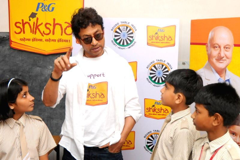 Actor Irrfan Khan with children at the P&G Shiksha school in New Delhi on April 30,2015.