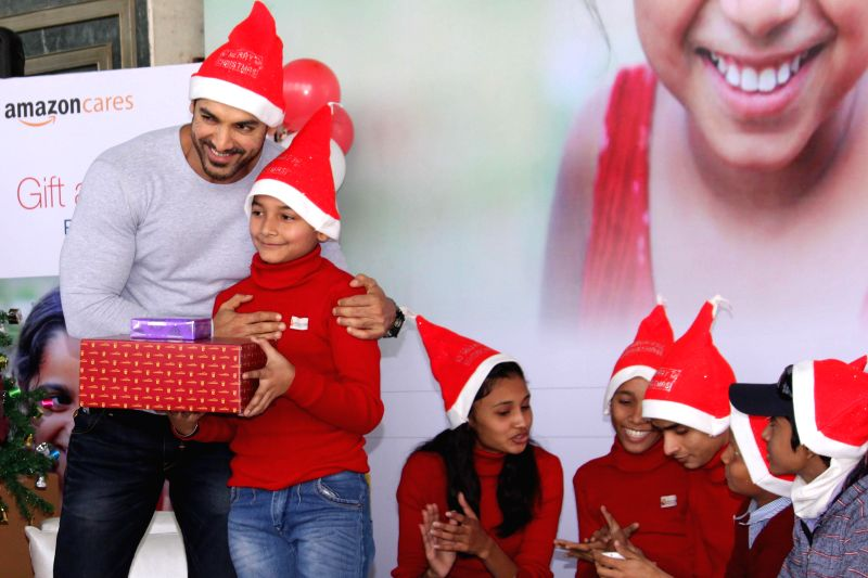 Actor John Abraham during a Christmas celebration programme organised for the terminally ill and underprivileged children in New Delhi, on Dec 15, 2014.