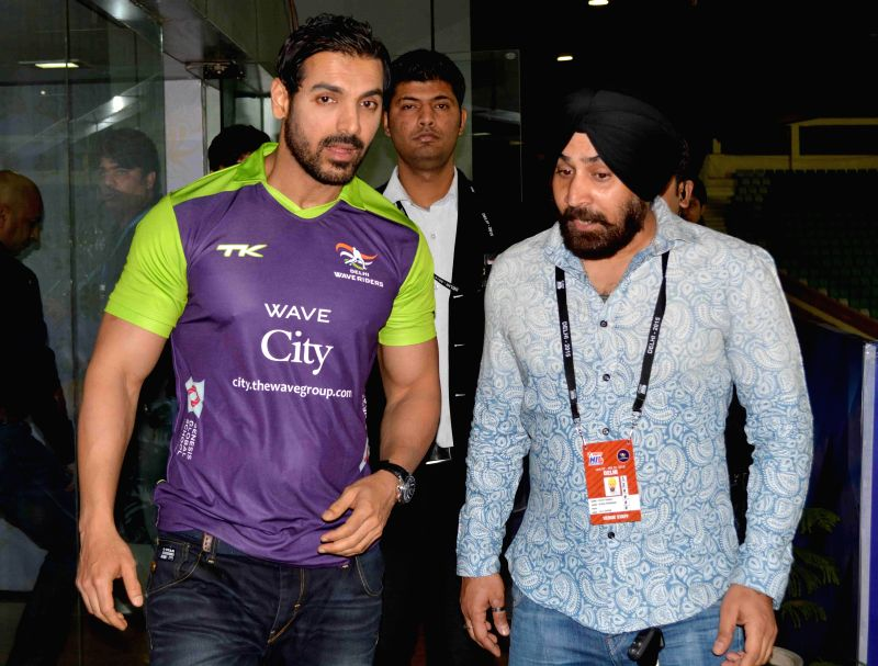Actor John Abraham during a Hockey India League match between Delhi Waveriders and Ranchi Rays in New Delhi, on Feb 12, 2015. (Photo : IANS) - John Abraham