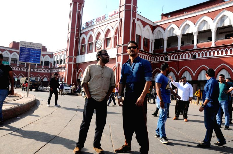 Actor Sushant Singh Rajput with filmmaker Dibakar Banerjee during a promotional event of their film `Detective Byomkesh Bakshy!` at old Delhi Railway Station on March 27, 2015. - Sushant Singh Rajput and Dibakar Banerjee