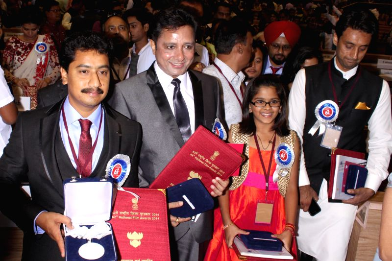 Actor Vijay Kumar B, singers Sukhwinder Singh and Uthara Unnikrishnan at the 62nd National Film Awards ceremony organised at Vigyan Bhavan in New Delhi, on May 3, 2015. - Vijay Kumar B and Sukhwinder Singh