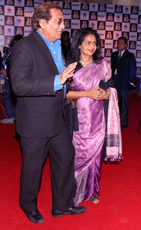 Actor Vinod Khanna during a programme organised to celebrate 21 years of a `Aap Ki Adalat` a TV show at Pragati Maidan in New Delhi on Dec 2, 2014. - Vinod Khanna