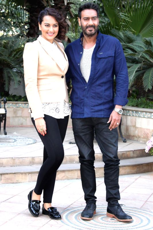 Actors Ajay Devgn and Sonakshi Sinha during a press conference to promote their upcoming film `Action Jackson` in New Delhi, on Dec 3, 2014.