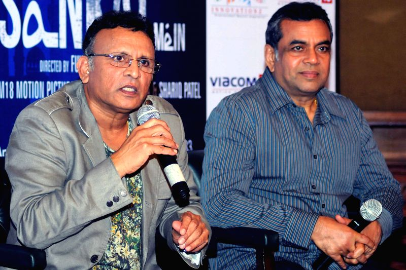 Actors Annu Kapoor and Paresh Rawal during a press conference to promote their upcoming film `Dharam Sankat Mein` in New Delhi, on April 6, 2015. - Annu Kapoor and Paresh Rawal