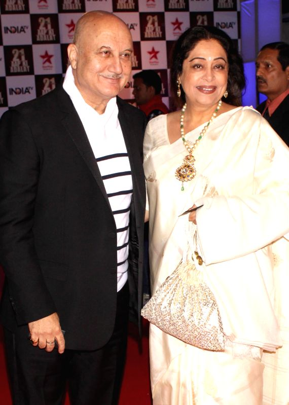Actors Anupam Kher and Kirron Kher during a programme organised to celebrate 21 years of a `Aap Ki Adalat` a TV show at Pragati Maidan in New Delhi on Dec 2, 2014. - Anupam Kher and Kirron Kher