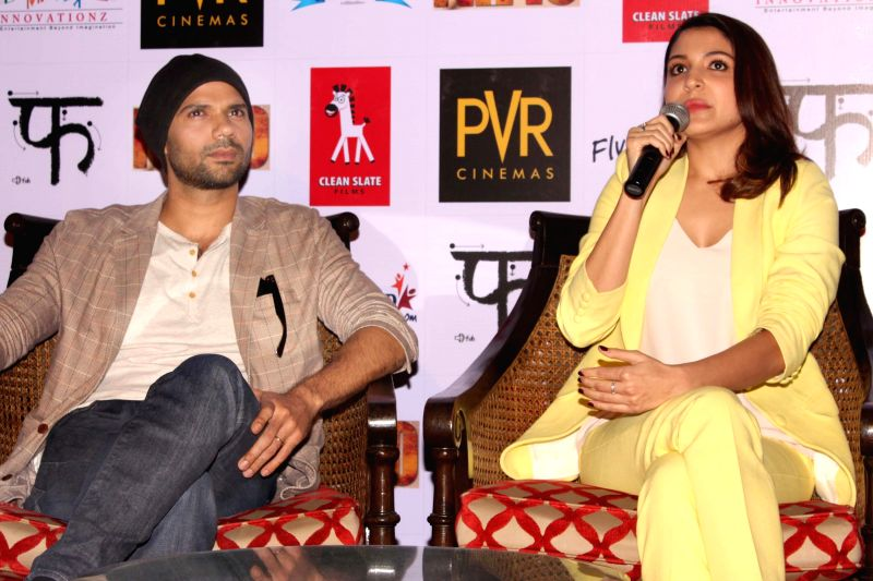 Actors Anushka Sharma and Neil Bhoopalam during a press conference to promote their upcoming film `NH 10` in New Delhi, on March 9, 2015. - Anushka Sharma and Neil Bhoopalam