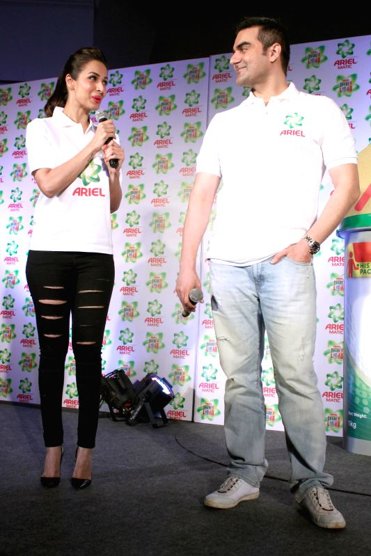 Actors Arbaaz Khan and Malaika Arora Khan during a programme, in New Delhi on March 11, 2015.
