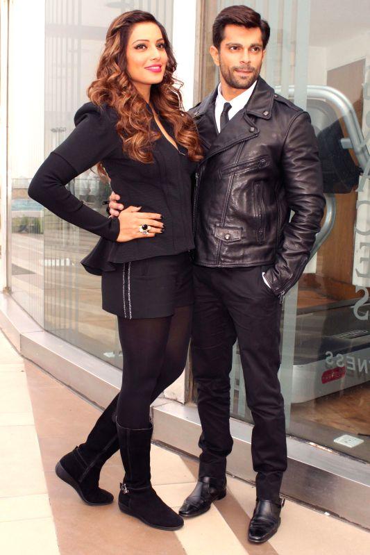 Actors Bipasha Basu and Karan Singh Grover during a press conference to promote their upcoming film `Alone` in New Delhi, on Jan 12, 2015. - Bipasha Basu and Karan Singh Grover