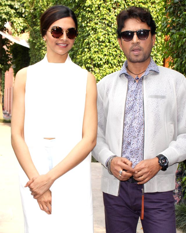 Actors Deepika Padukone and Irrfan Khan during a press conference to promote their upcoming film `Piku` in New Delhi, on May 4, 2015. - Deepika Padukone and Irrfan Khan