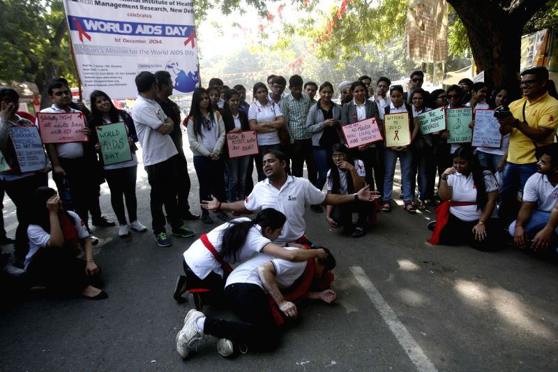 Actors enact a street play at Jantar Mantar on World AIDS Day in New Delhi on Dec 1, 2014.