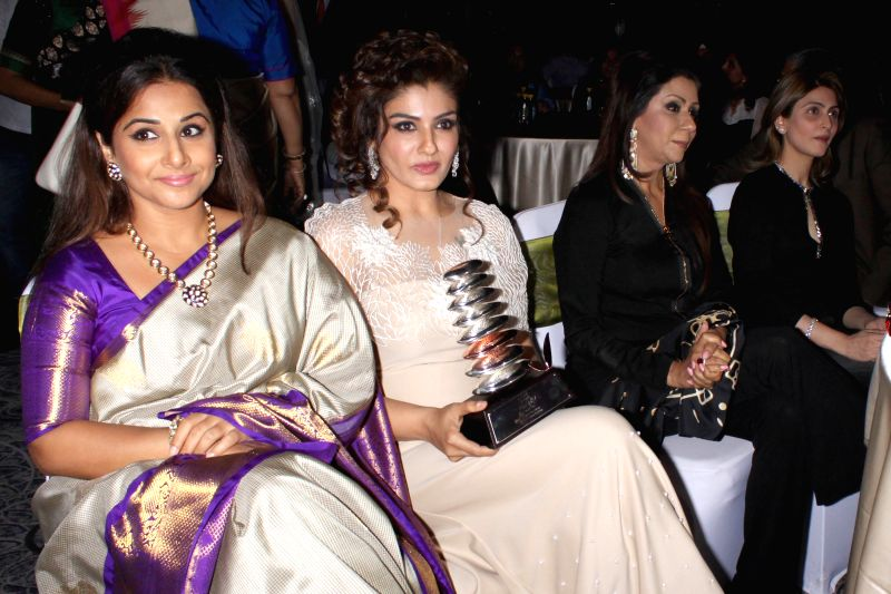 Actors Raveena Tandon and Vidya Balan during GeoSpa asiaSpa India Awards 2014, in New Delhi on March 30, 2015. - Raveena Tandon and Vidya Balan