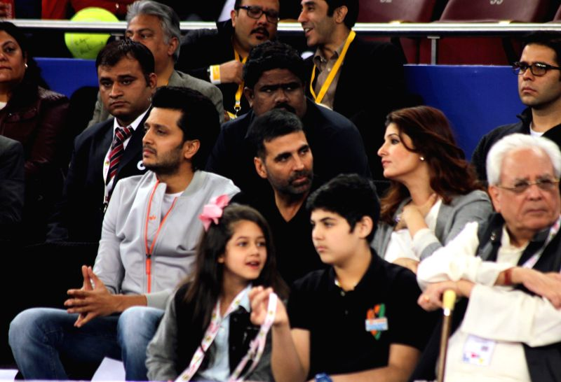 Actors Riteish Deshmukh, Akshay Kumar and Twinkle Khanna during an IPTL match at Indira Gandhi Indoor Arena in New Delhi, on Dec 8, 2014.