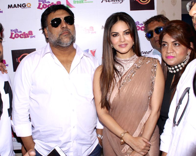 Actors Sunny Leone and Ram Kapoor during the promotion of film `Kuch Kuch Locha Hai` in New Delhi on May 4, 2015. - Sunny Leone and Ram Kapoor
