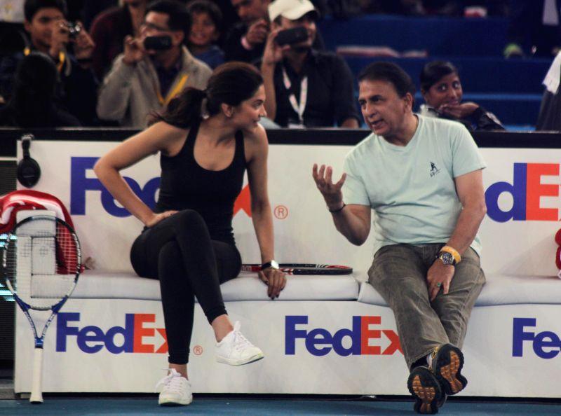 Actress Deepika Padukone with former cricketer Sunil Gavaskar during an IPTL match at Indira Gandhi Indoor Arena in New Delhi, on Dec 8, 2014.