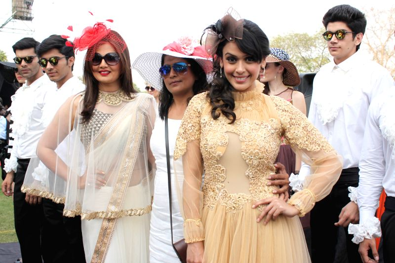 Actress Deepshikha Nagpal and Hrishitaa Bhatt during the `The Rolli Stud Farm Million Cup` at Delhi Race course, in New Delhi on April 6, 2015.