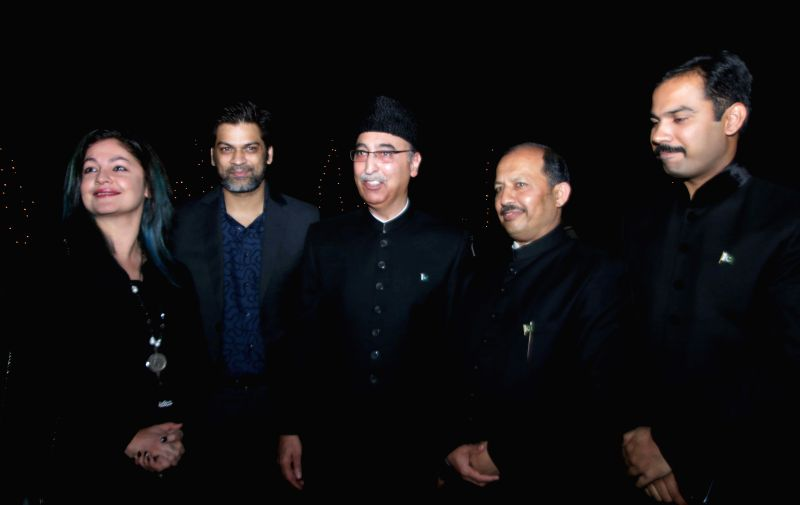 Actress-filmmaker Pooja Bhatt with the Pakistan High Commissioner to India Abdul Basit and others during a programme organised at the Pakistan High Commission on Pakistan National Day, in ...