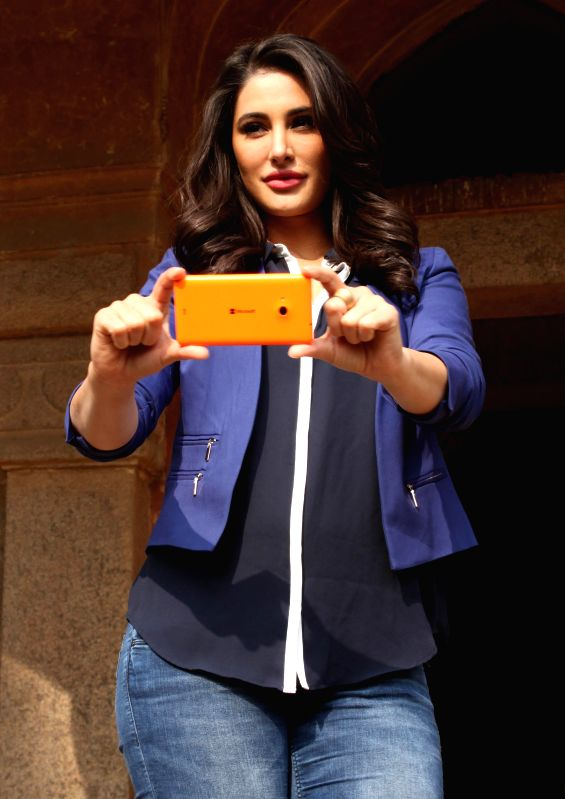 Actress Nargis Fakhri during a promotional programme organised by Microsoft at Lodhi Garden, in New Delhi on Dec. 18, 2014.
