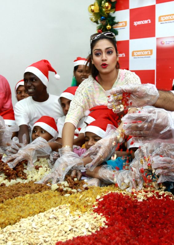 Actress Nusrat Jahan during `Truly Christmas` a cake mixing programme in Kolkata, on Dec 5, 2014. - Nusrat Jahan