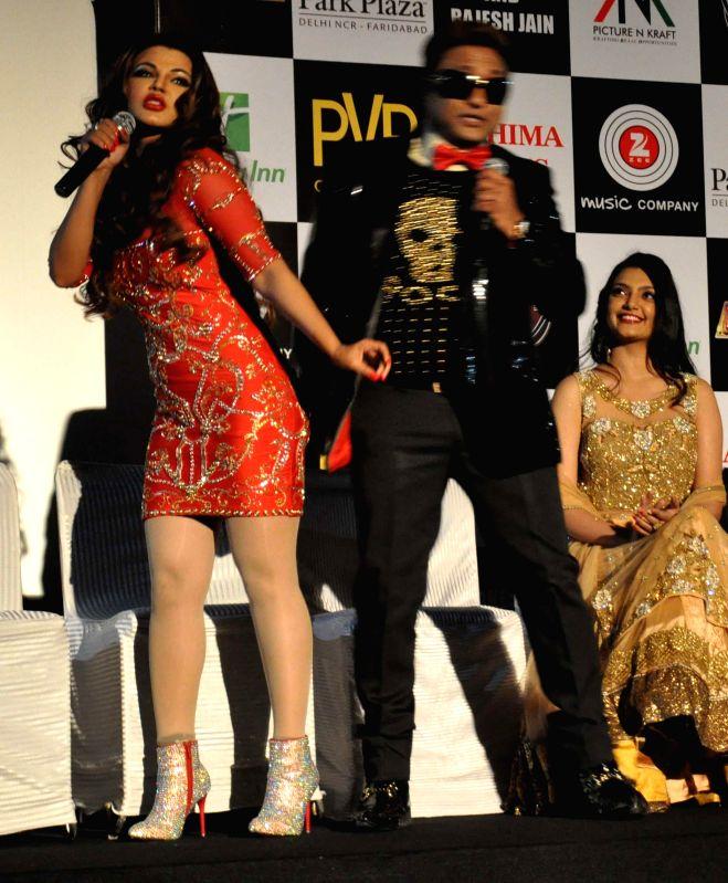 Actress Rakhi Sawant performs during the grand premiere of the film `Mumbai Can Dance Saalaa` in New Delhi on Jan 1, 2015. - Rakhi Sawant