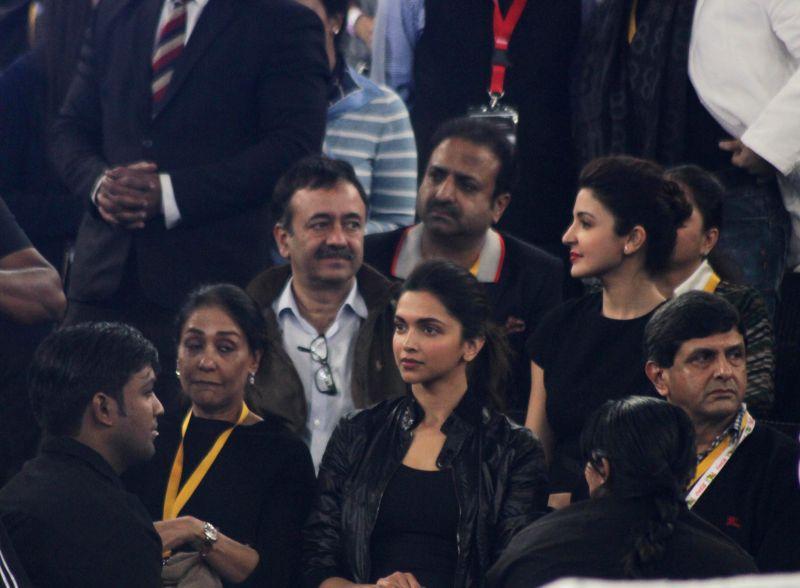 Actresses Deepika Padukone, Anushka Sharma, filmmaker Rajkumar Hirani, former badminton player Prakash Padukone and others during an IPTL match at Indira Gandhi Indoor Arena in New Delhi, . - Prakash Padukone