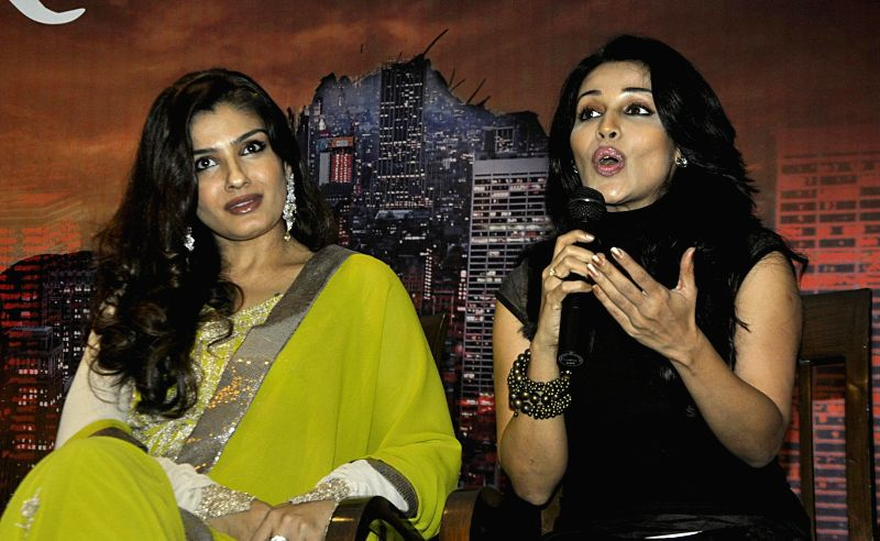 Actresses Raveena Tandon with Asha Saini at the launch of the poster of upcoming film `RAB NAA` in New Delhi, on Feb 18, 2015. - Raveena Tandon