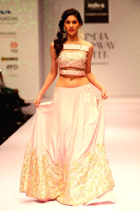 Actresss Amyra Dastur walks on the ramp at India Runway Week show, in New Delhi, on April 12, 2014.