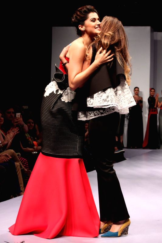 Actresss Taapsee Pannu walks on the ramp at India Runway Week show, in New Delhi, on April 12, 2014.