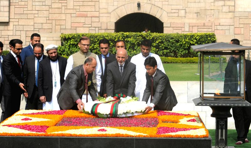 Afghanistan President Dr. Mohammad Ashraf Ghani lays wreath at the Samadhi of Mahatma Gandhi, at Rajghat, in Delhi on April 28, 2015. Also seen the Union Minister of State for Finance ... - Jayant Sinha