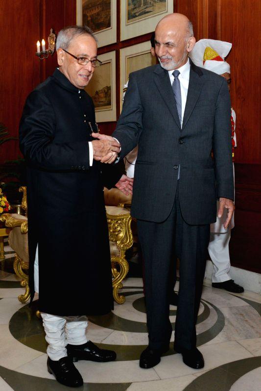 Afghanistan President Dr. Mohammad Ashraf Ghani calls on President Pranab Mukherjee at Rashtrapati Bhavan in New Delhi, on April 28, 2015. - Pranab Mukherjee