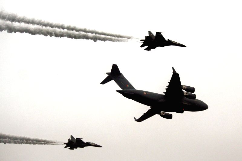 Aircraft of the Indian Air Force fly past the Rajpath during Republic Day celebrations in New Delhi, on Jan 26, 2015.