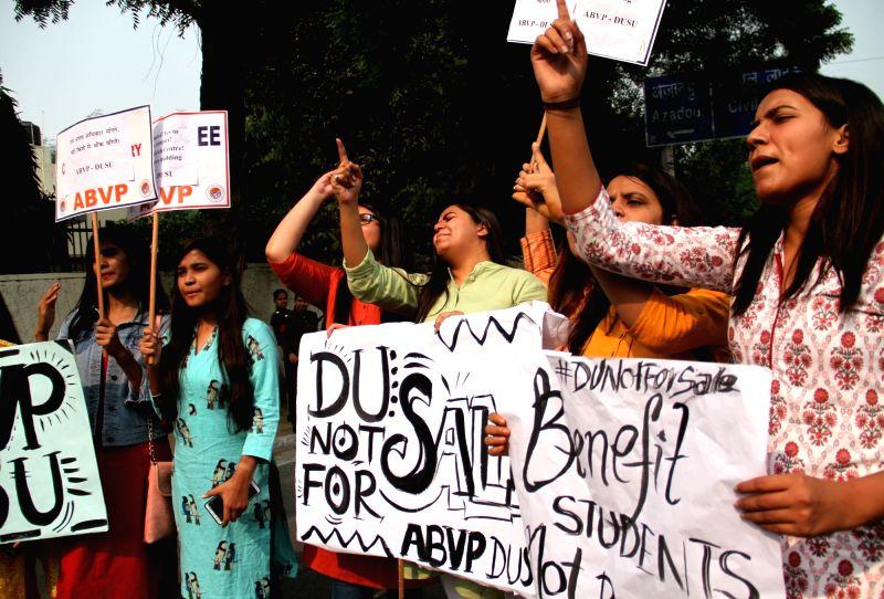 New Delhi: Akhil Bharatiya Vidyarthi Parishad (ABVP) members stage a demonstration against the proposed construction of a 39-storey building near North Campus, in New Delhi on Nov 12, 2019. (Photo: IANS)