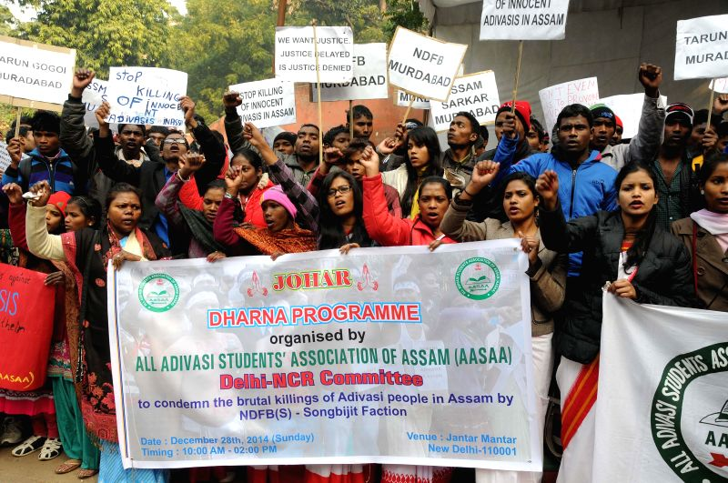 All Adivasi Students' of Assam  (AASAA)  stage a demonstration against the recent Assam violence in which 73 people were killed, in New Delhi on Dec 28, 2014.