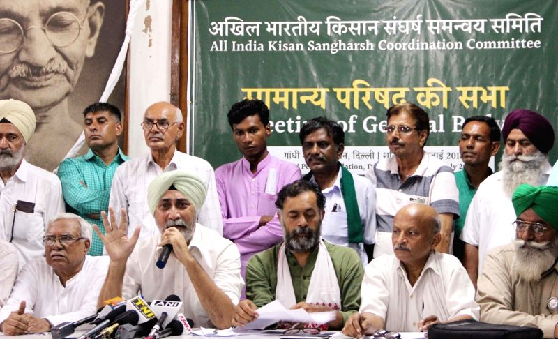 :New Delhi: All India Kisan Sangharsh Coordination Committee (AIKSCC) convener VM Singh and member Yogendra Yadav during a press conference, in New Delhi on July 14, 2018. (Photo: IANS).