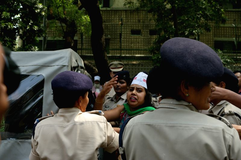 An Aam Aadmi Sena worker staging a demonstration in front of Delhi Chief Minister Arvind Kejriwal's residence being taken away by police in New Delhi on April 29, 2015. - Arvind Kejriwal