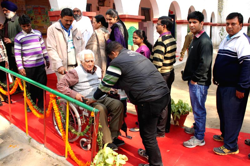An elderly gentleman after casting his vote at a polling booth during Delhi Assembly Polls in New Delhi, on Feb 7, 2015.
