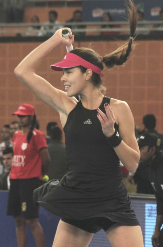 Ana Ivanovic of Indian Aces in action during an IPTL women's singles match against Daniela Hantuchova of Singapore Slammers at Indira Gandhi Indoor Arena in New Delhi, on Dec 7, 2014. ...