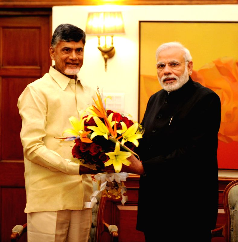 Andhra Pradesh Chief Minister N. Chandrababu Naidu calls on the Prime Minister Narendra Modi, in New Delhi on Feb 15, 2015. - N. Chandrababu Naidu and Narendra Modi