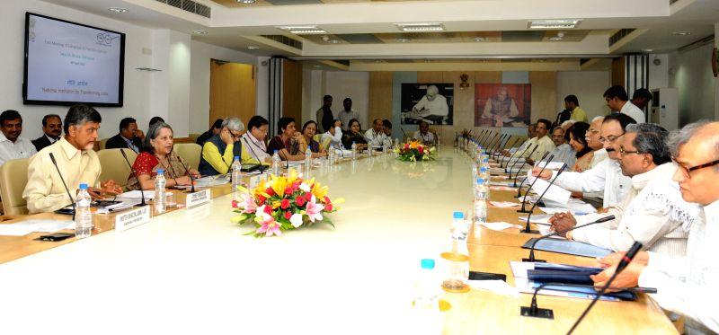 Andhra Pradesh Chief Minister N. Chandrababu Naidu chairs the first meeting of the sub-Group of Chief Ministers on Swachh Bharat Abhiyaan, at NITI Aayog, in New Delhi on April 30, 2015. ... - N. Chandrababu Naidu and Manohar Lal Khattar