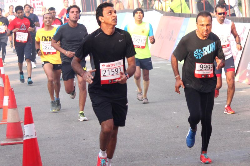 Anil Ambani in the Airtel Delhi Half Marathon at Jawaharlal Nehru Stadium in New Delhi on Nov 23, 2014. - Ambani