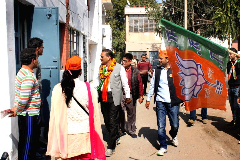 Anil Sharma, BJP Candidate from R K Puram,constituency during door-to-door campaign, in New Delhi on Jan 31, 2015. - Sharma